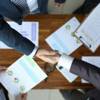 men-shake-hands-table-with-reports_151013-10861