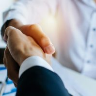 partnership-two-business-people-shaking-hand-after-business-job-interview-meeting-room-office_33829-103